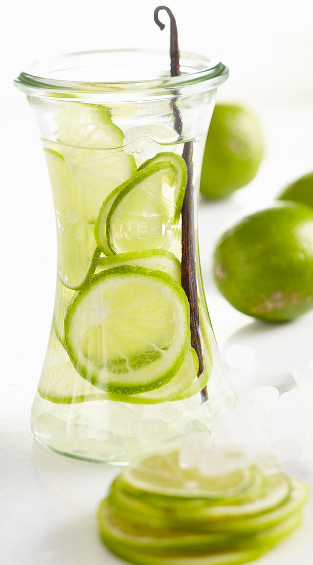 Homemade lime liqueur in a preserving jar