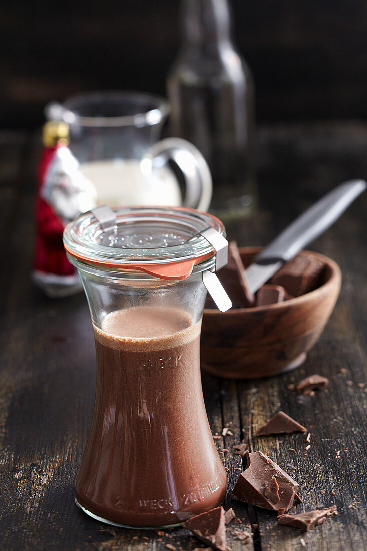 Homemade chocolate liqueur with cocoa, cream, honey and rum