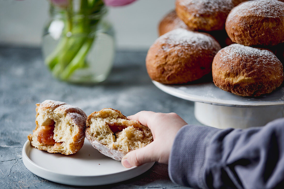 Donuts with jam and powdered sugar