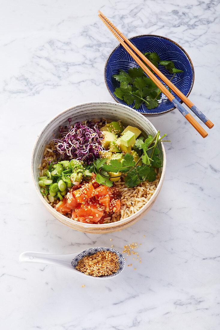 Poke bowl with sushi salmon and wholegrain rice