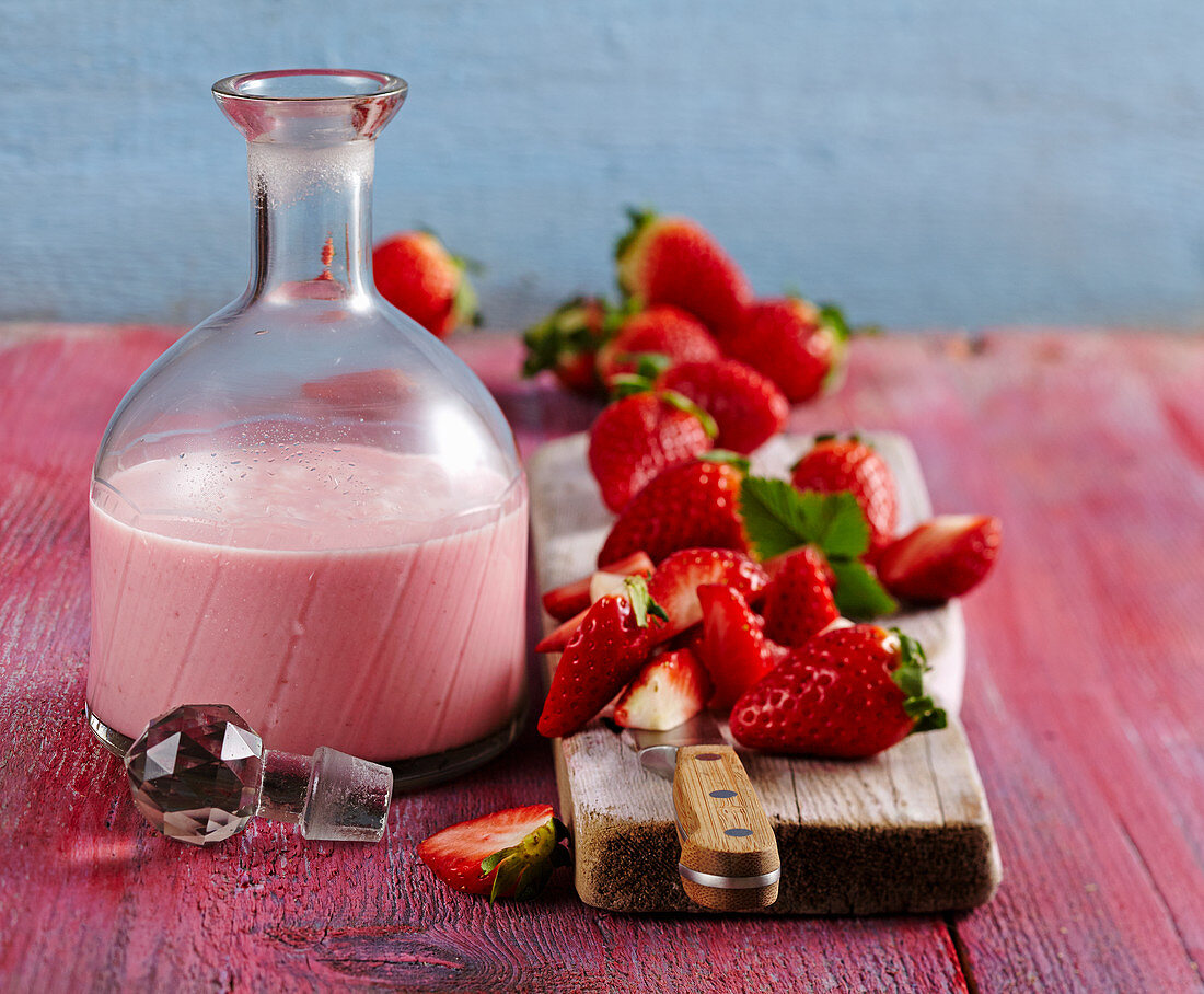 Homemade strawberry cream liqueur with fresh berries and vodka