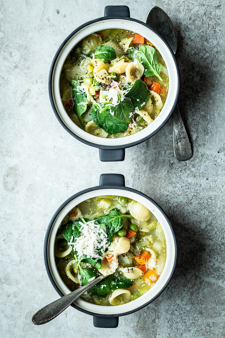 Vegetable soup with orecchiette pasta and grated cheese
