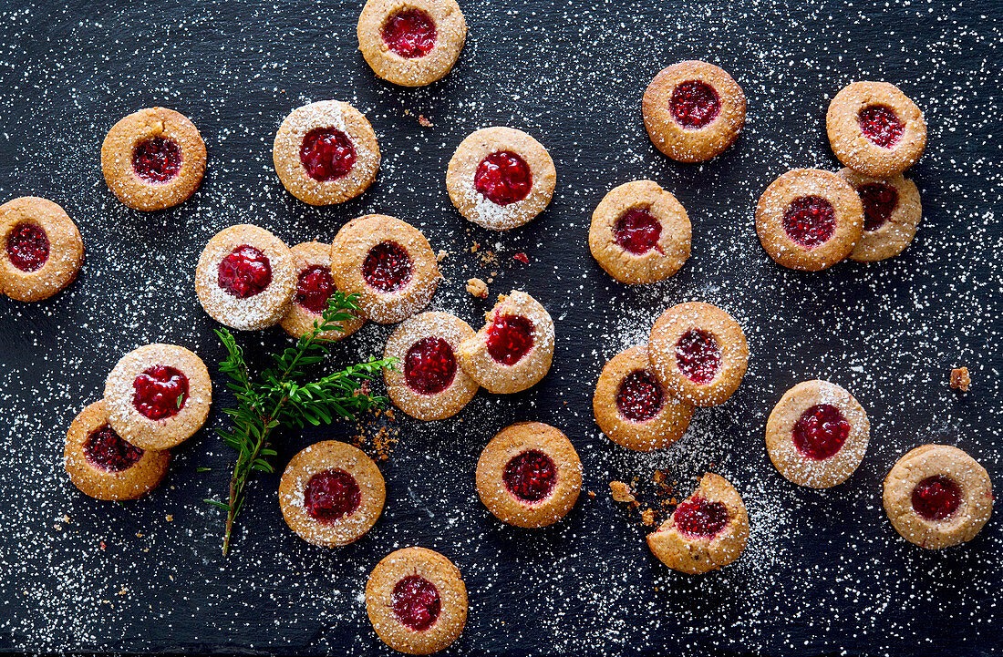 Linzer Augen (nutty shortcrust jam sandwich biscuits with holes on top for Christmas)
