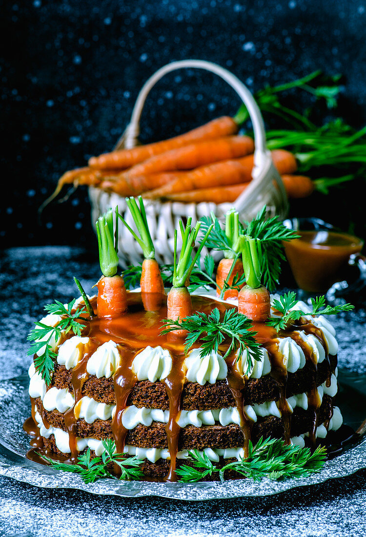 Carrot cake with salted caramel, garnished with fresh, fresh organic carrots