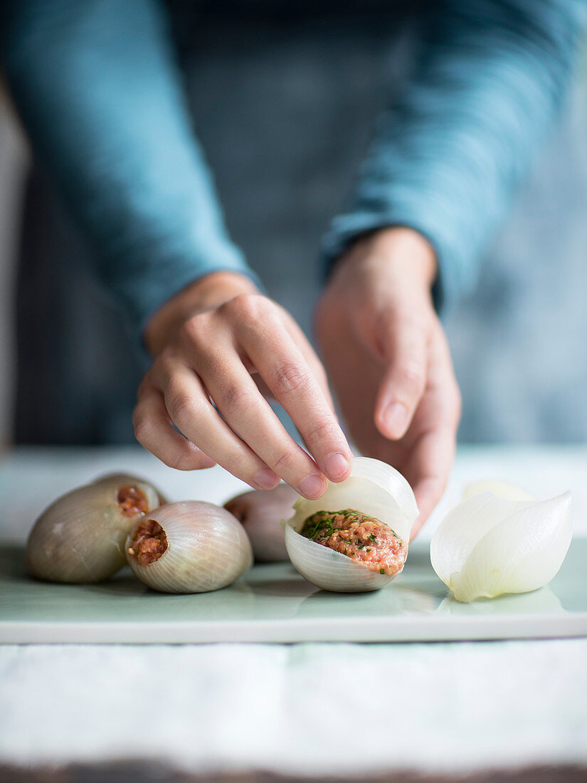 Stuffed onions being made