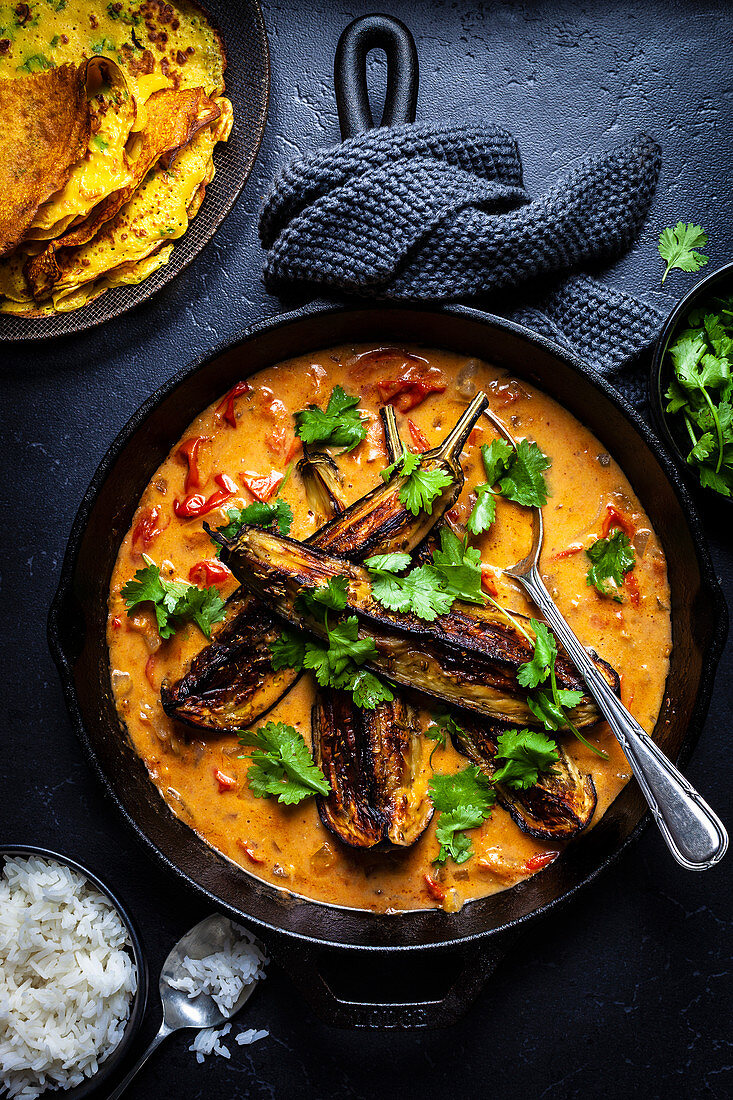 Roast Eggplant with Tomato Coconut Curry and Coriander Pudlas