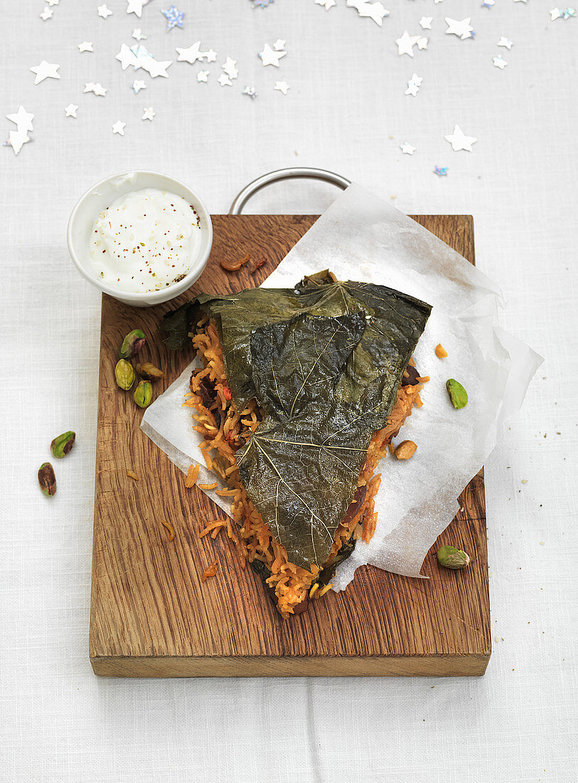 Persian rice cake with vine leaves and pistachios (Christmas)