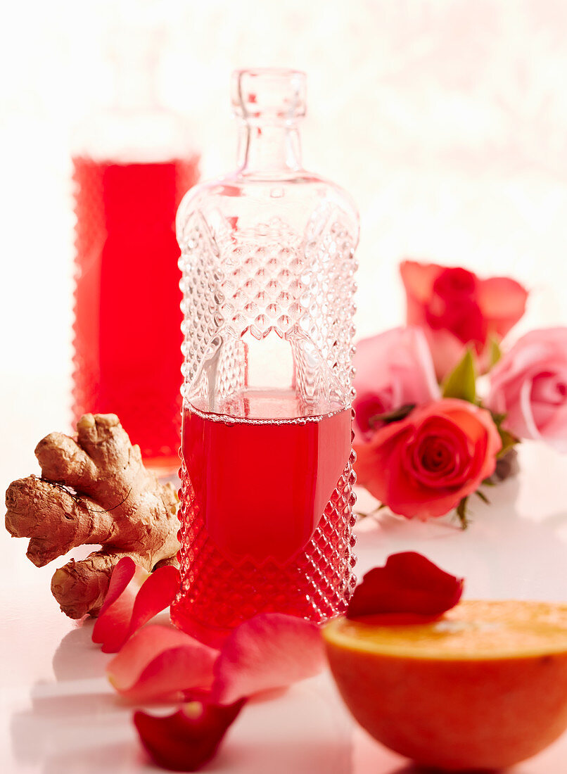 A bottle of homemade rose and ginger syrup with orange