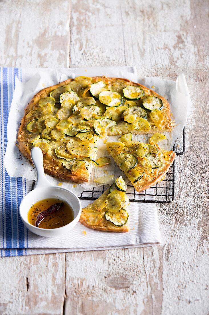 Potato pizza with zucchini and gruyere