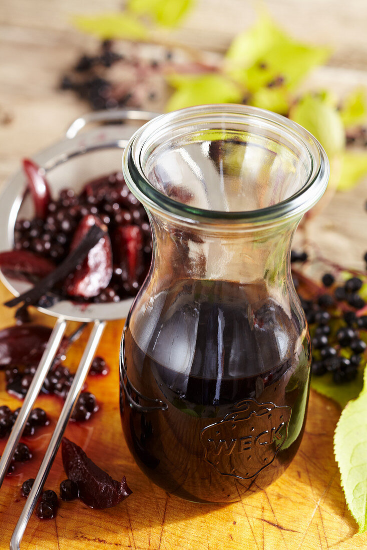 Homemade dark elderberry and plum liqueur with vodka and vanilla