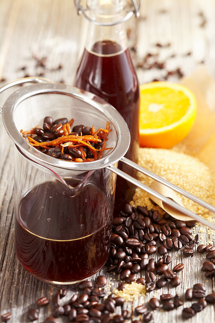 Homemade Brazilian coffee liqueur with orange, lemon, coffee beans and rum