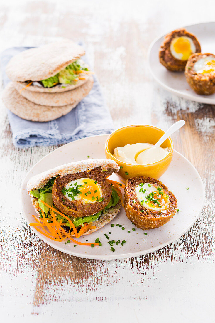 Meatballs filled with egg served in pita bread