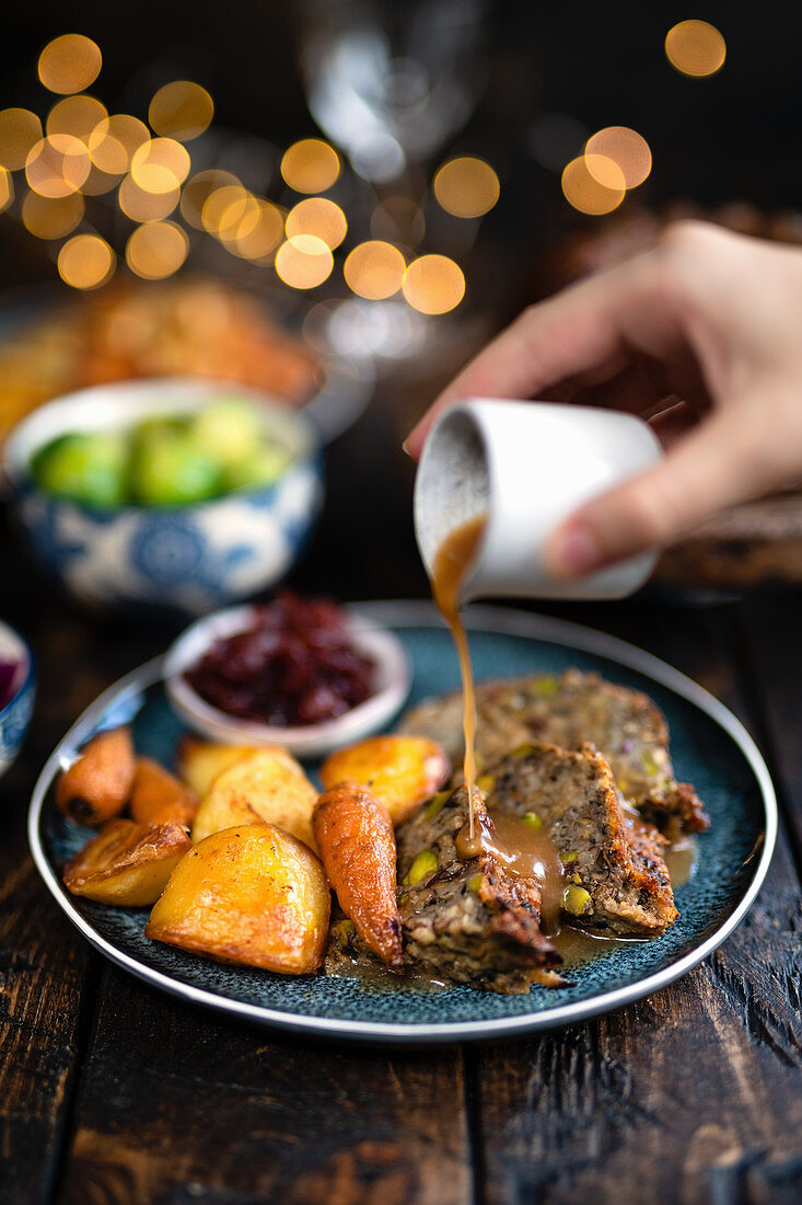 Vegetarian nut roast with roast vegetables and gravy