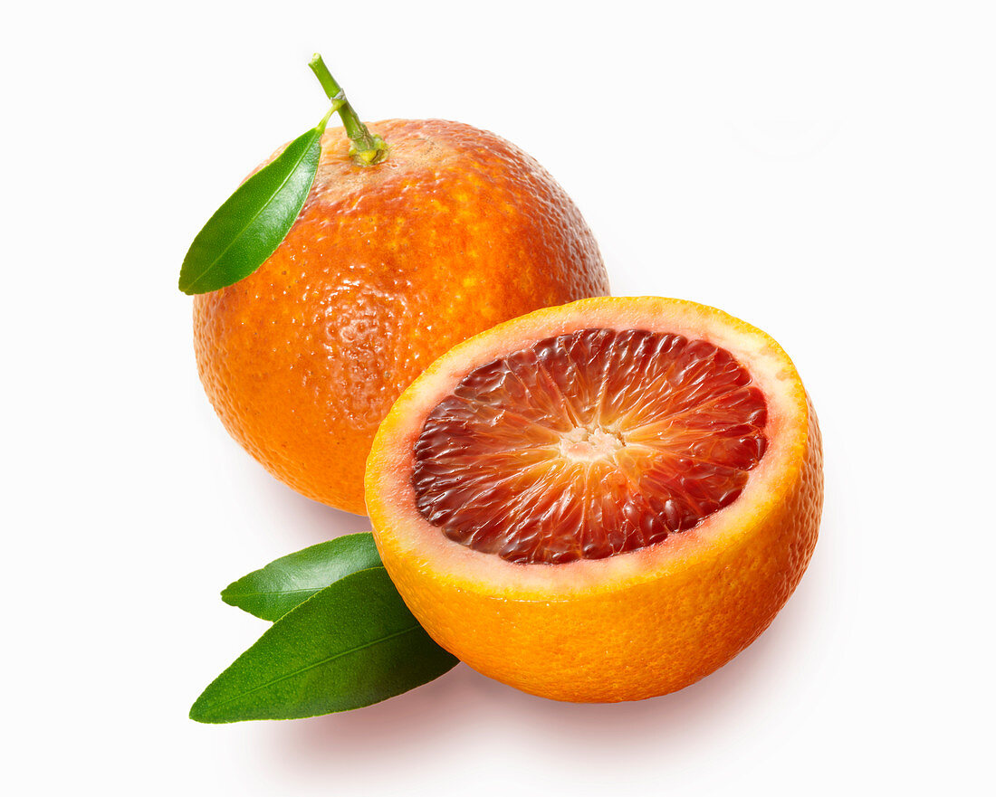 Blood orange whole and halved with leaves