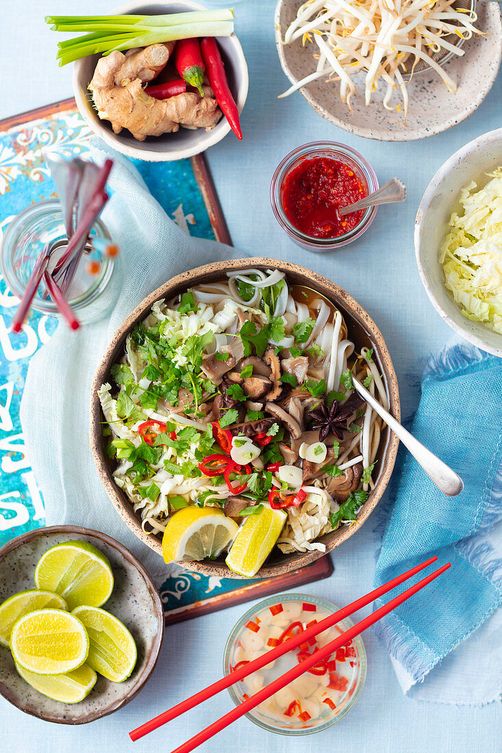 Vegan pho soup with shiitake and oyster mushrooms