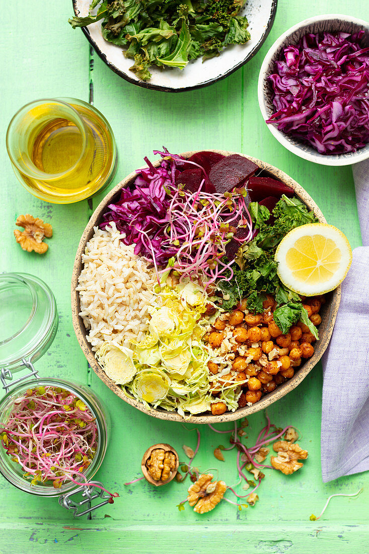 Buddha bowl (vegan) with rice, baked chickpeas, brussel sprouts, kale, red cabbage and beetroots