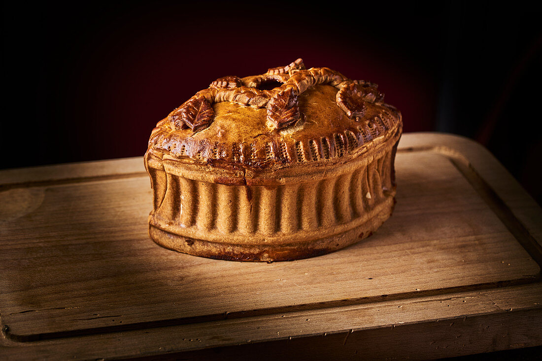 Puff pastry pie on a wooden cutting board