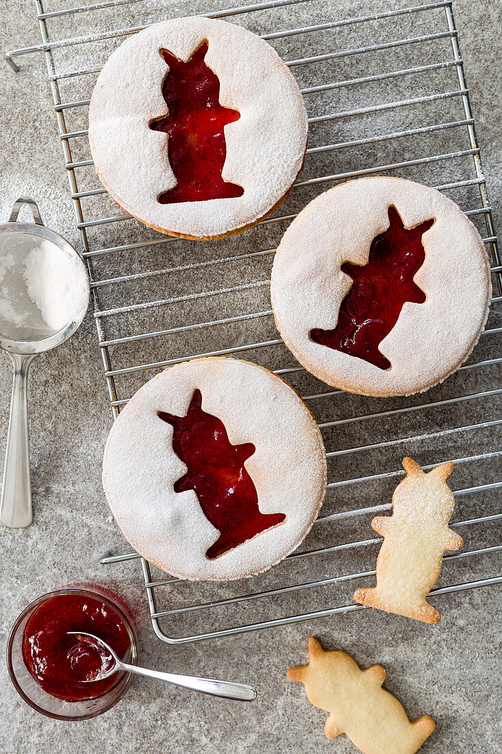 Jam cookies with Easter bunny motifs on a cooling grid