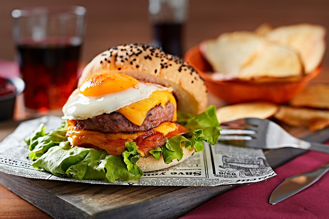 Delicious gourmet burger with fried eggs and cheese