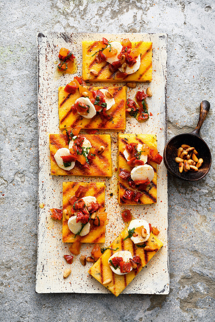 Grilled polenta with dried tomatoes and pine nuts
