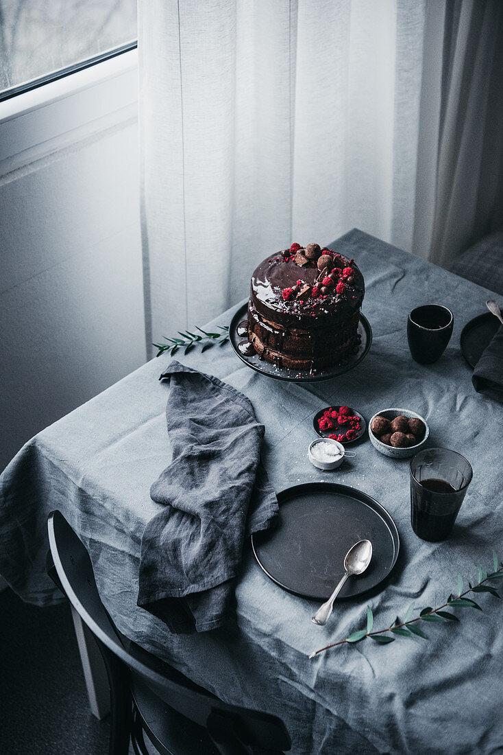 Paleo hazelnut cake with cranberry sauce and a chocolate glaze