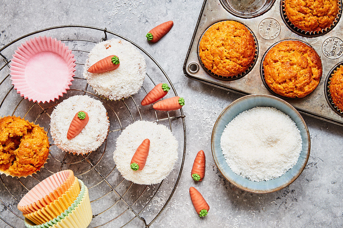 Carrot muffins with white chocolate, grated coconut and marzipan carrots