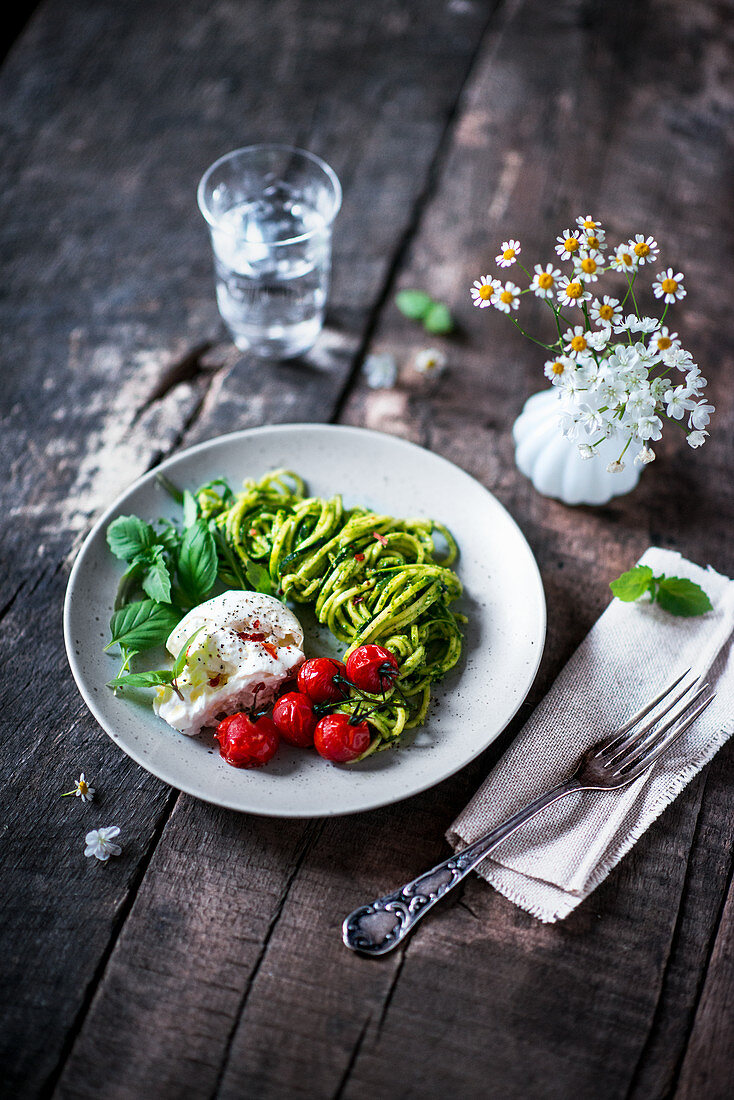Zoodles with pesto, oven-roasted tomatoes and buffalo mozzarella