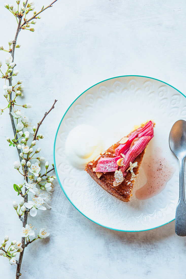 A slice of almond sponge with roasted rhubarb