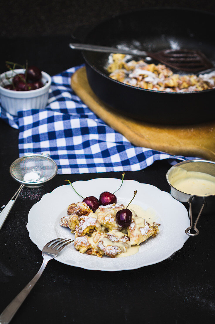 Kaiserschmarrn (shredded pancake) with cherries and vanilla sauce (low carb)