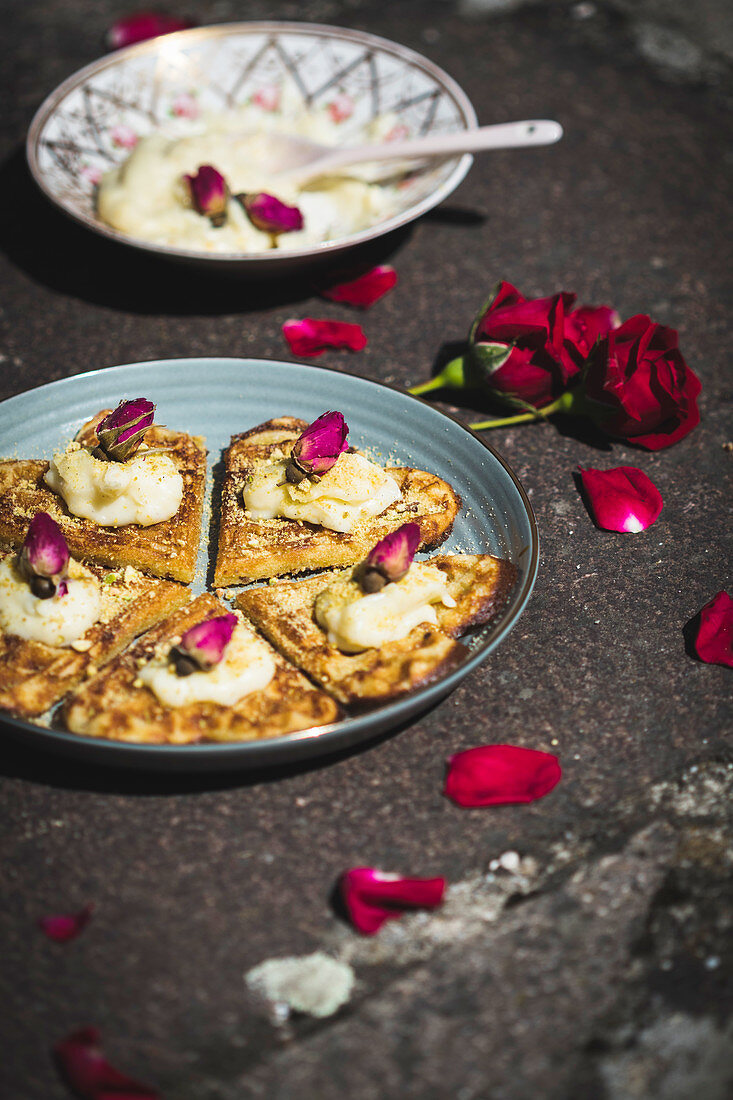 Heart-shaped waffle with pistachios, rose cream and rose petals