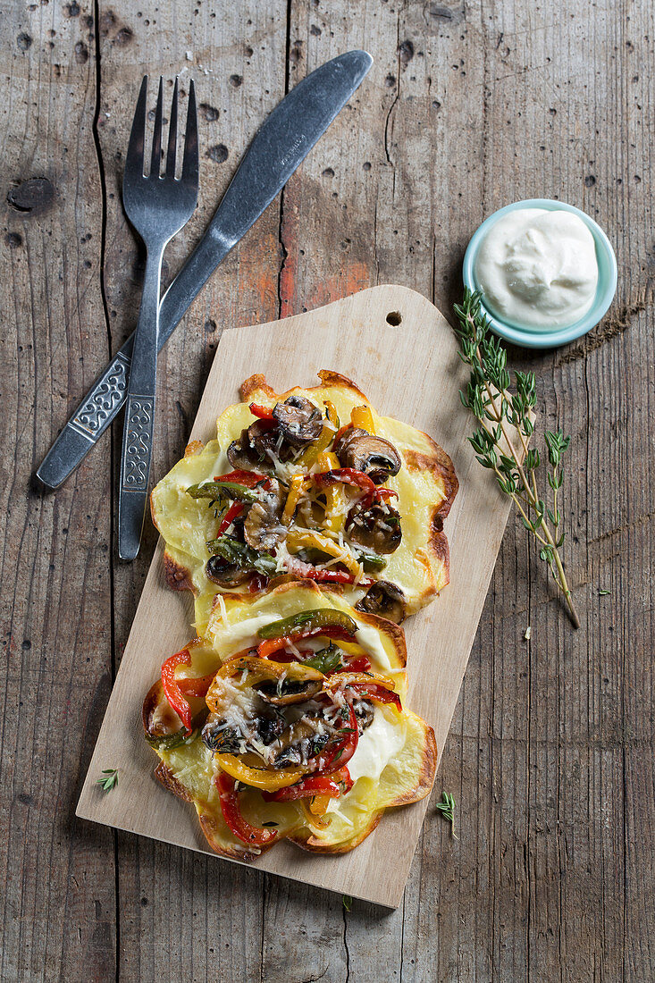 Potato pizzas topped with mushrooms and peppers