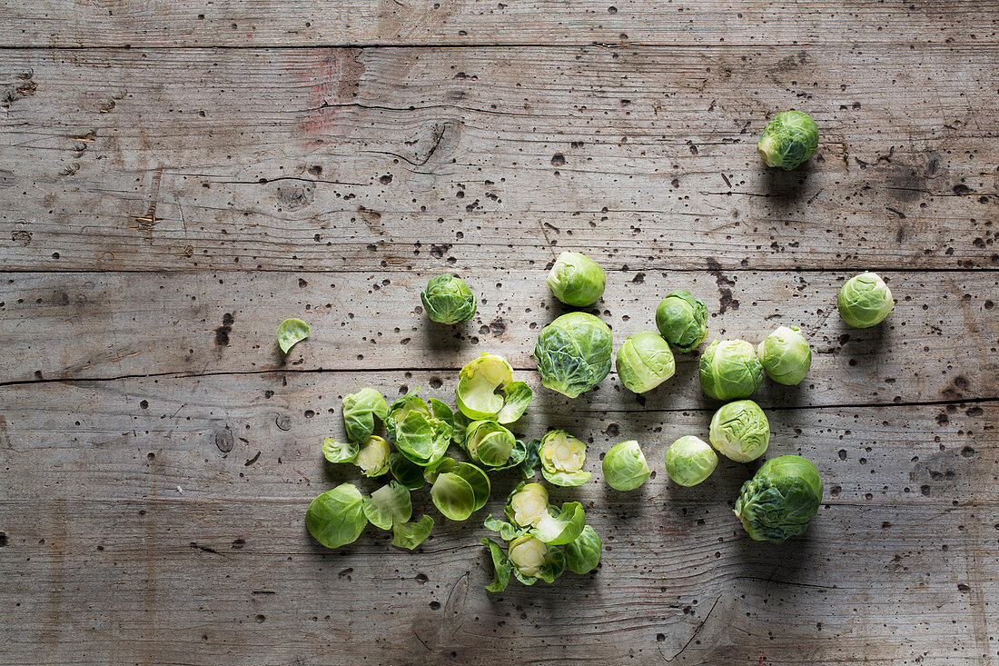 Fresh Brussels sprouts on a wooden surface
