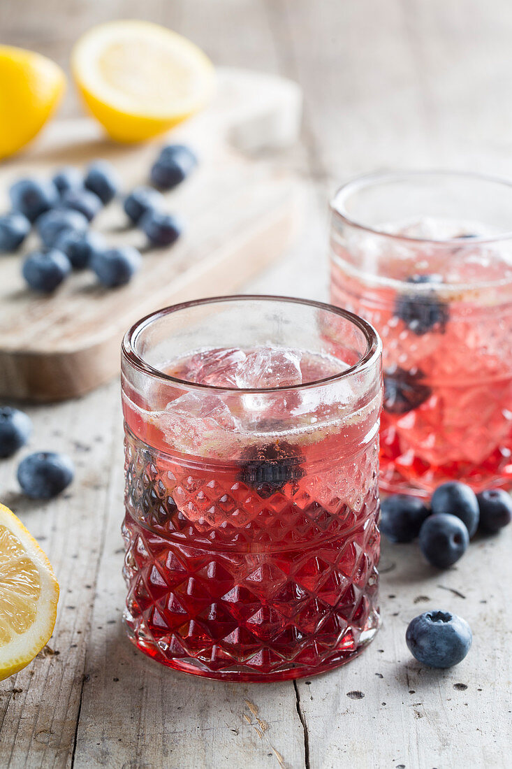 Cocktails with blueberries and ice cubes