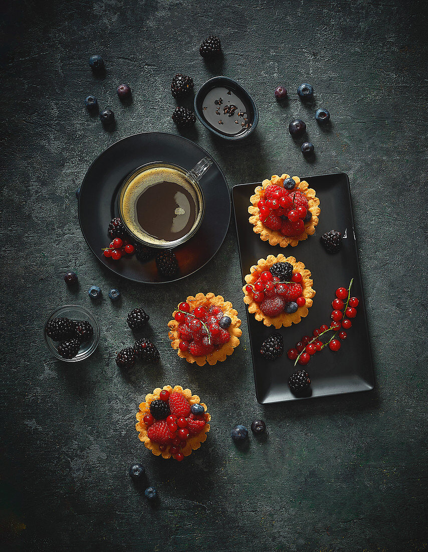 Summer berry tartlets with coffee
