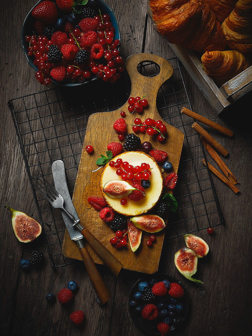 A dessert tartlet with summer berries and figs