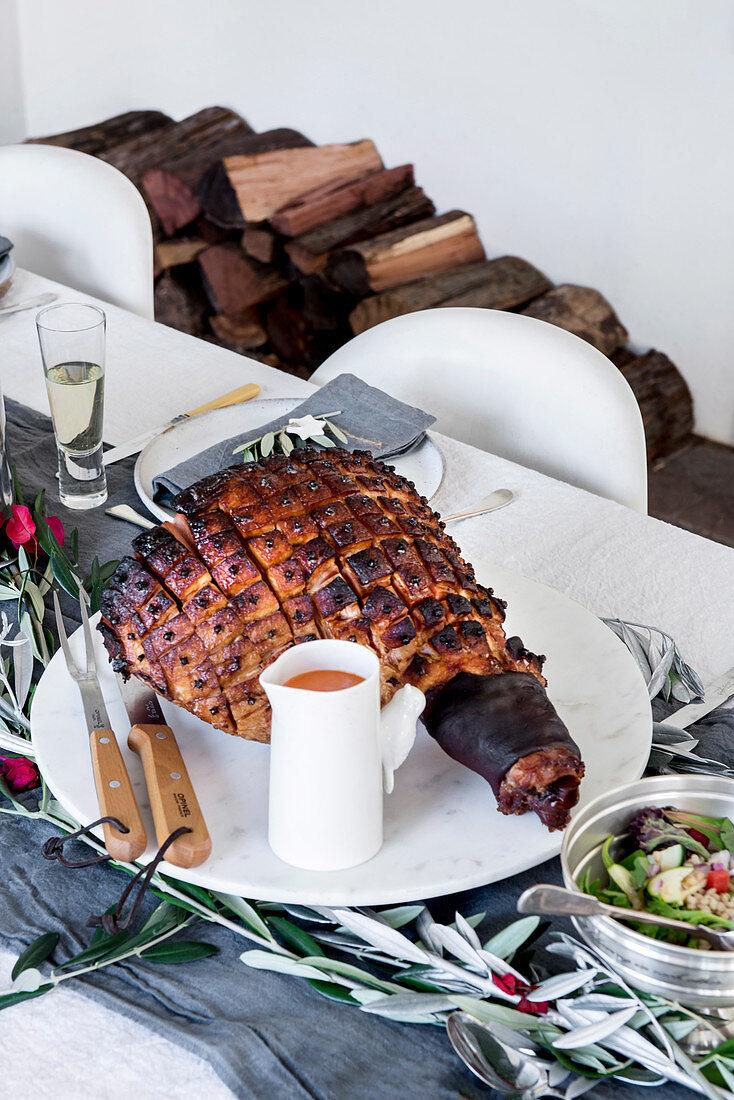 Roast ham on a set table