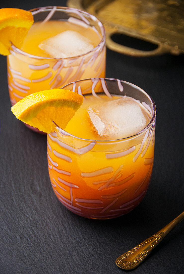 Two glasses filled with tropical guava punch