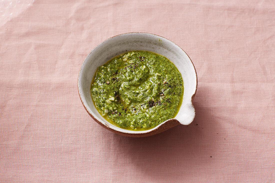 A green sauce dressing