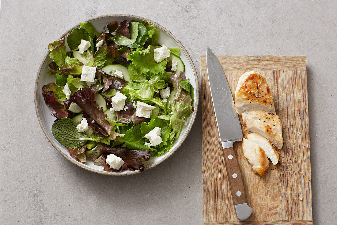 A basic salad made from various types of lettuce with filling sheep's cheese