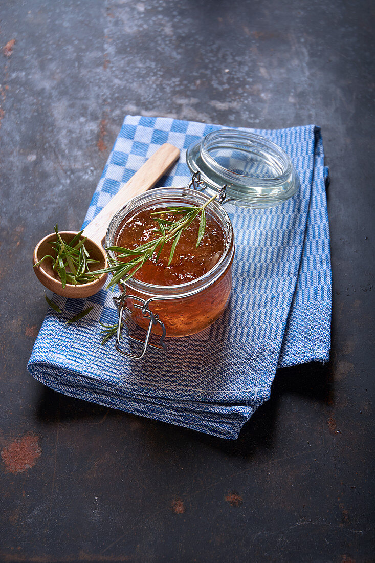 Quince jelly with rosemary on a kitchen towel