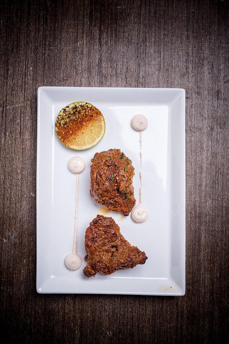 Beef tikka on a platter (India)