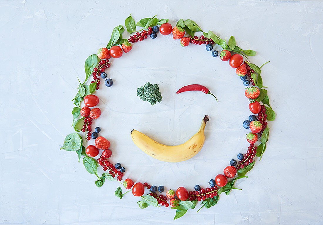 A smiling face made from fruit and vegetables