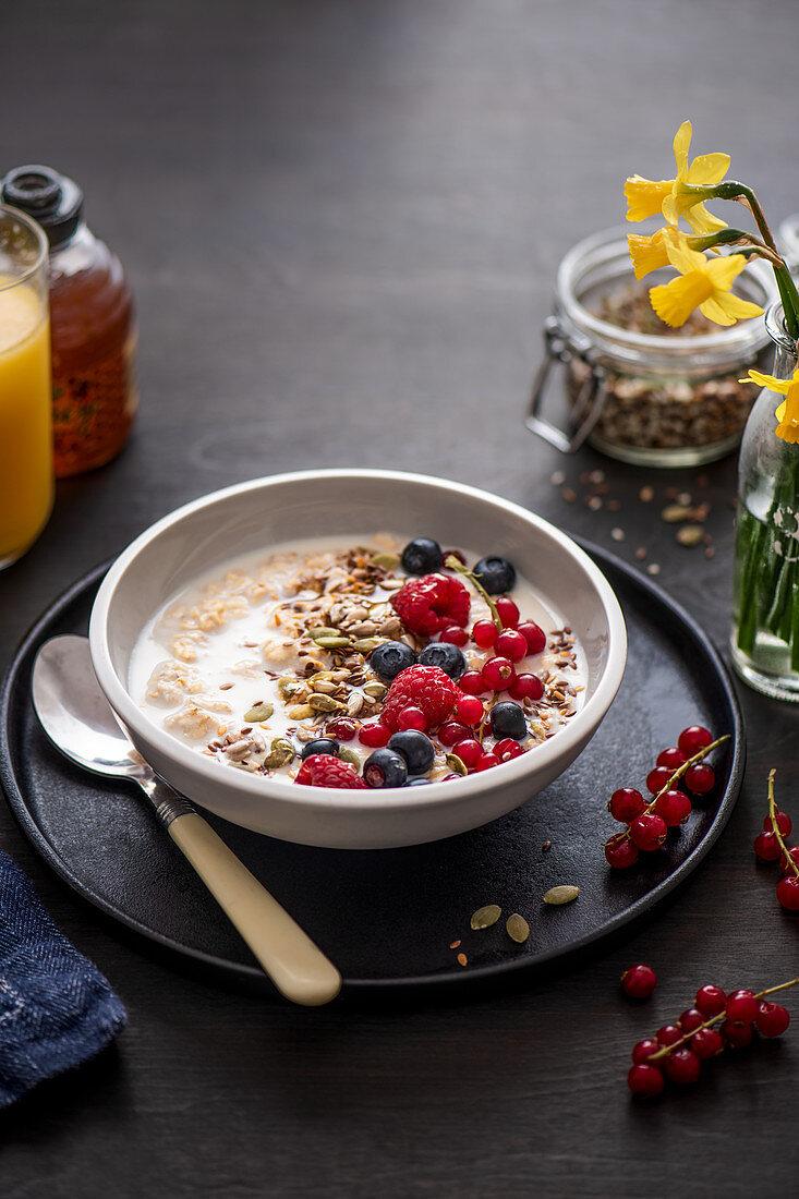 Bircher muesli (oats soaked in milk overnight) with honey and fresh fruit