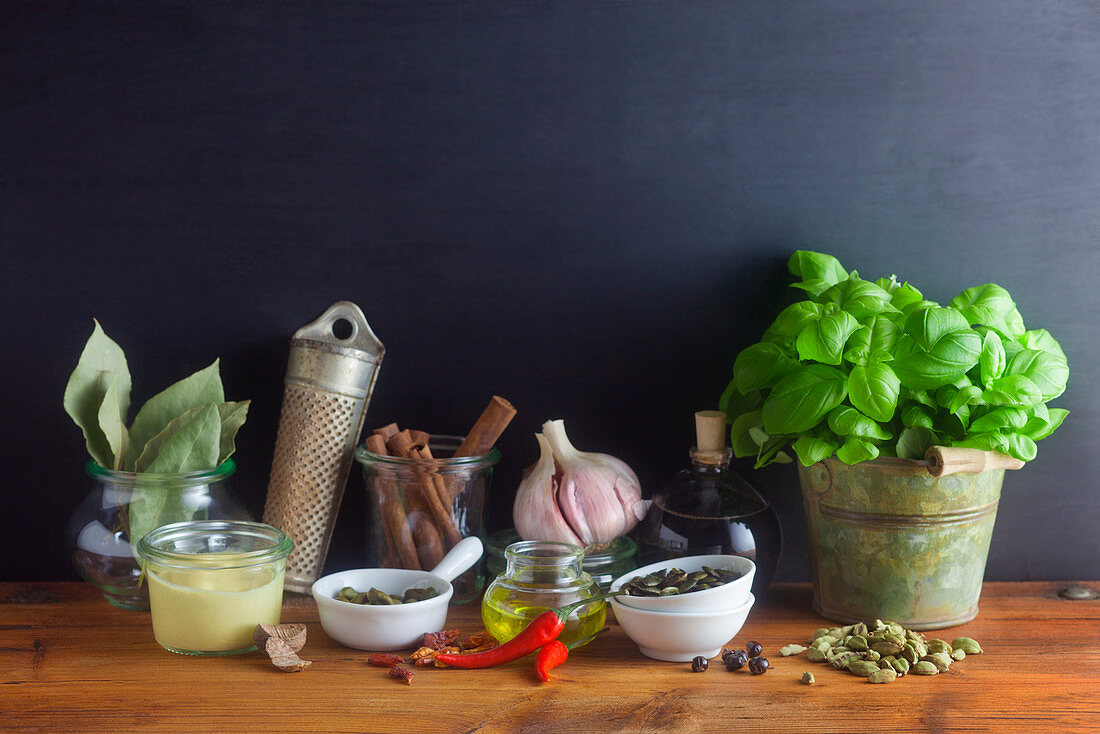 Still life with different spices and basil