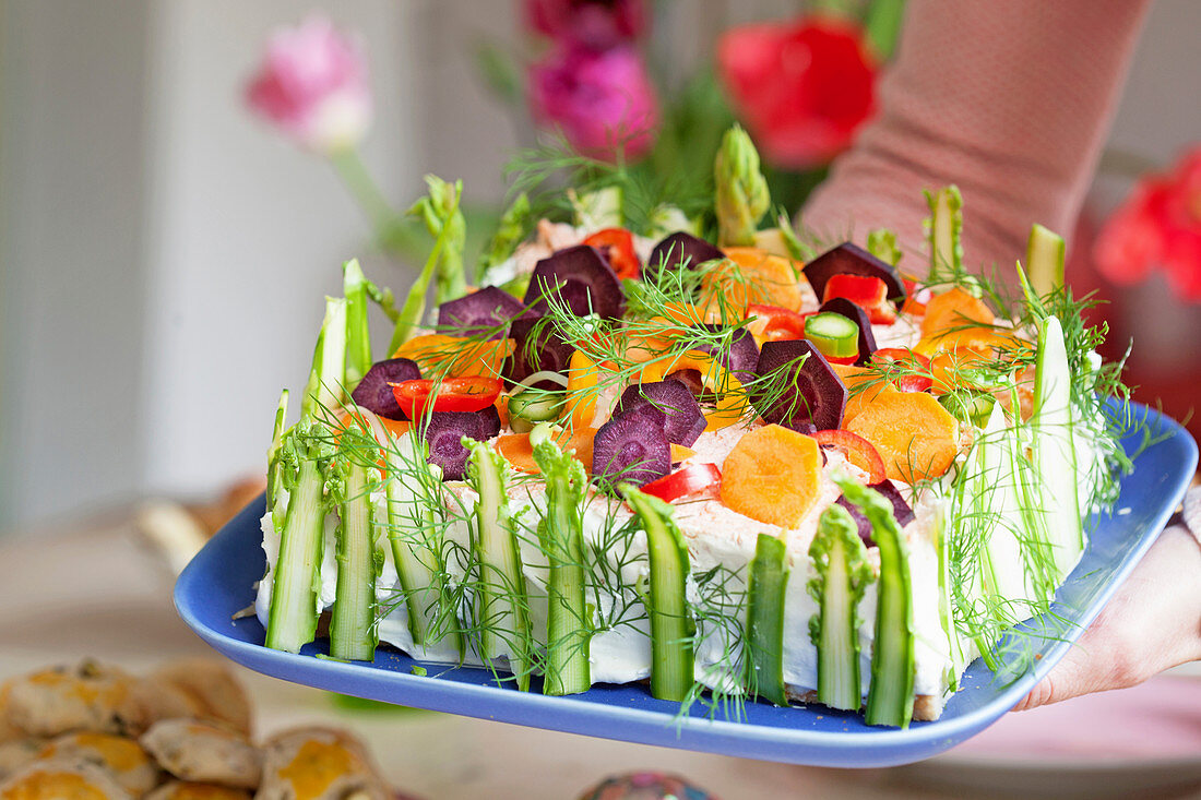 A savoury cake with salmon and vegetables