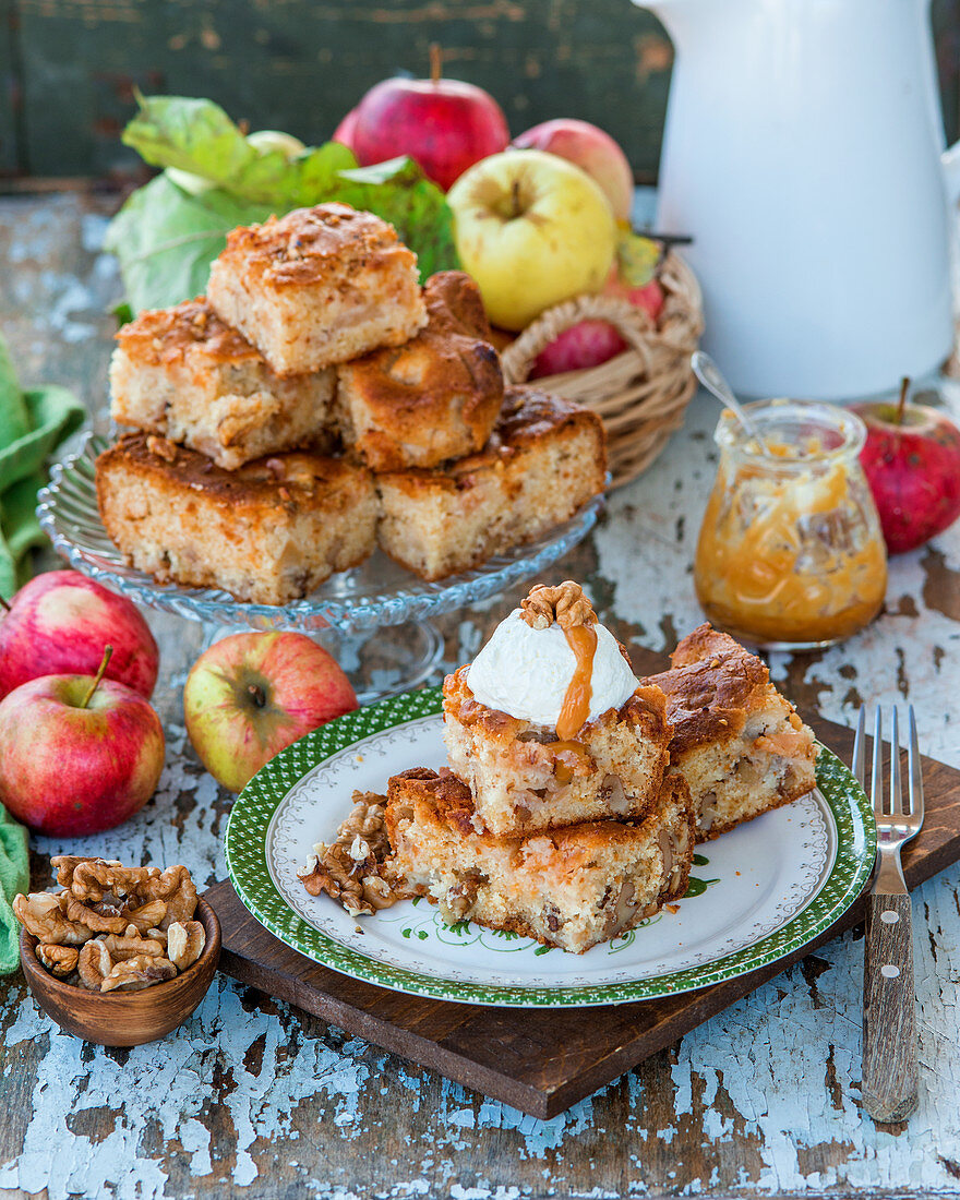 Apple blondies with walnuts, served with whipped cream and caramel sauce