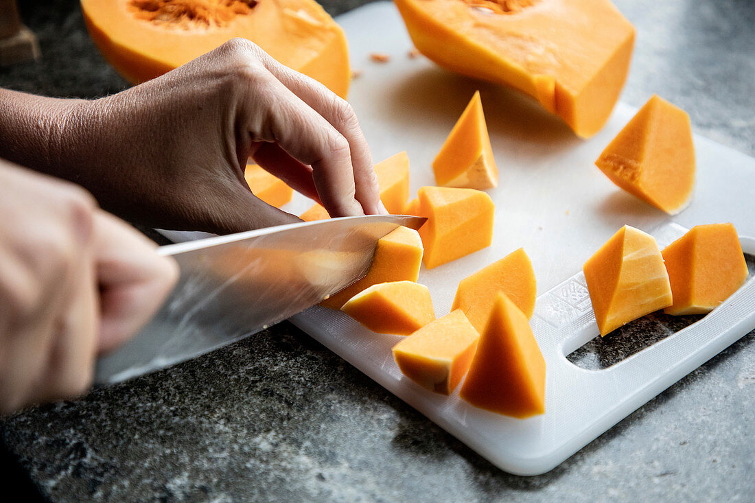 Cutting a pumpkin