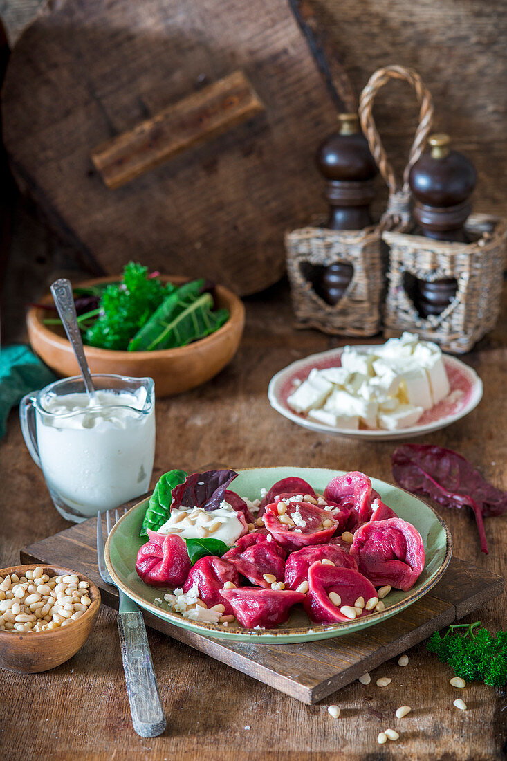 Beetroot pelmeni with pine nuts