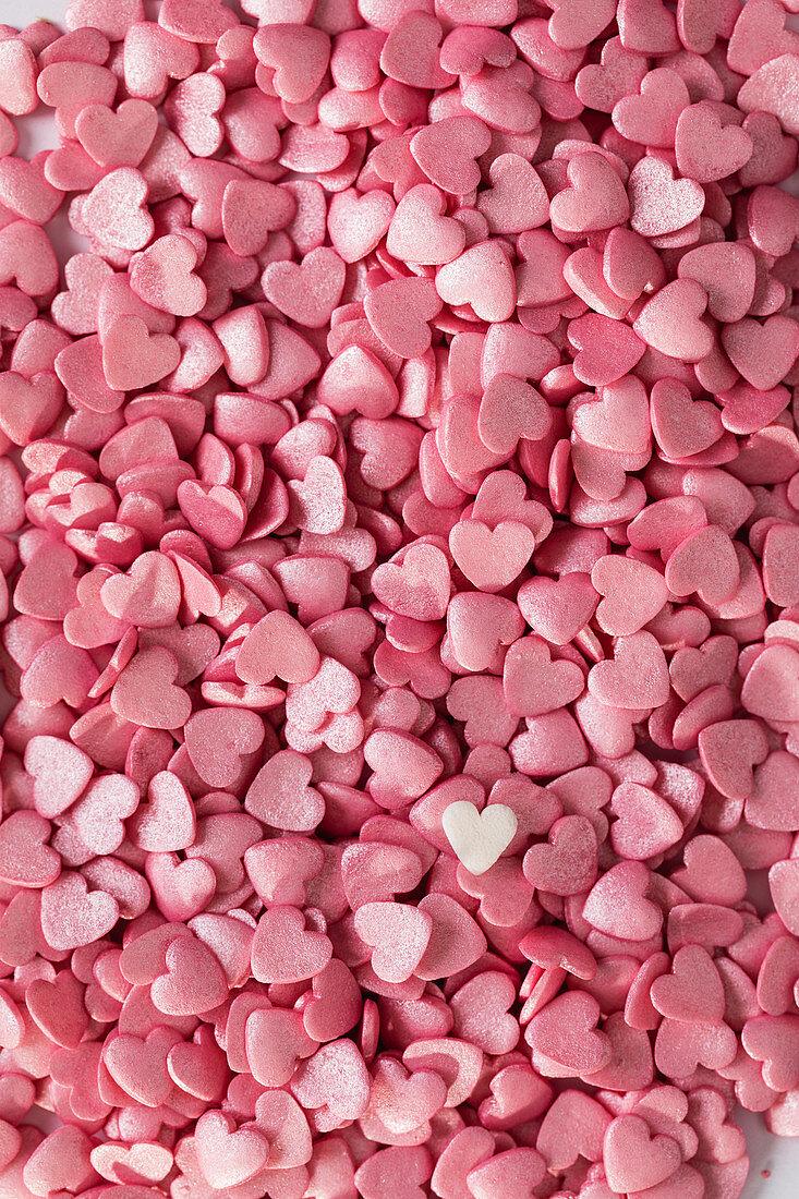 Pink sugar hearts as cake decoration