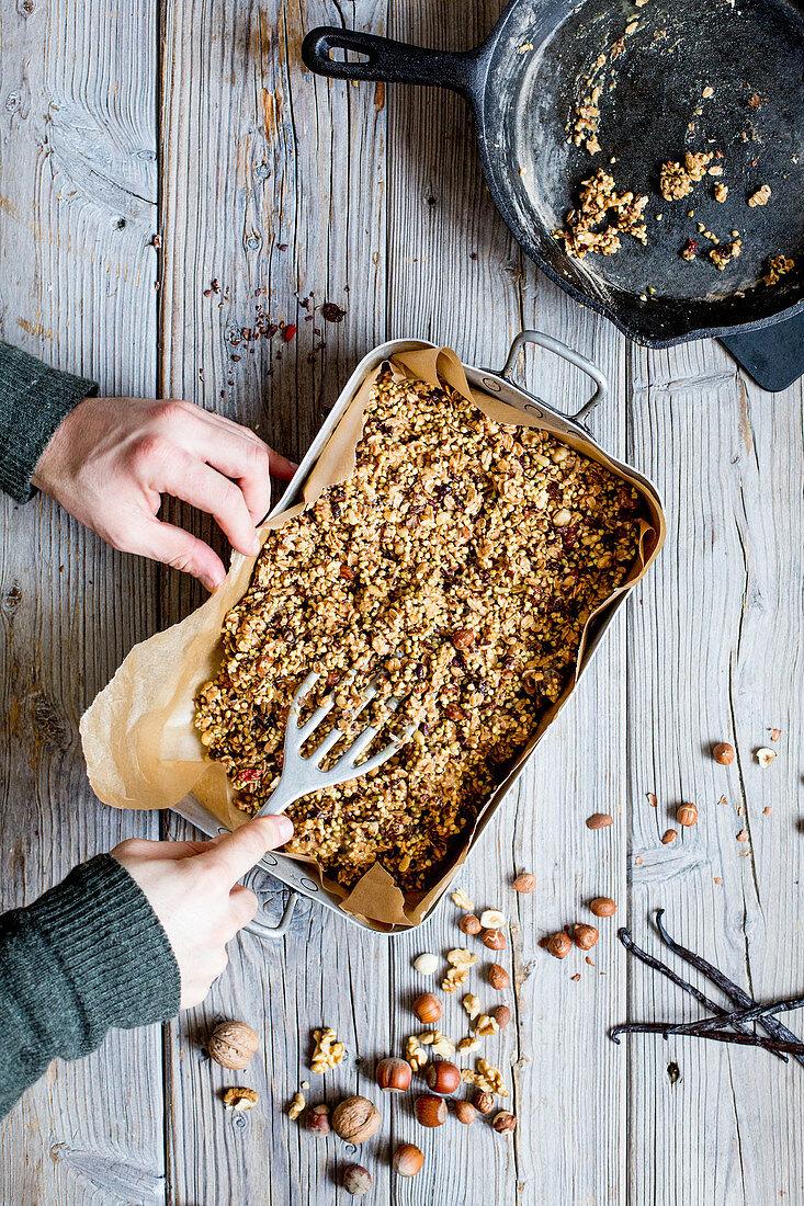 Making muesli bars at home: muesli mixture pressed into shape